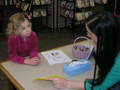Child getting a library card