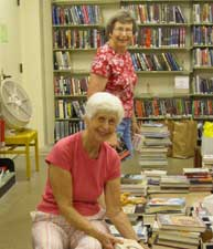 Friends of the Library sort through stacks of books for the bi-monthly book sale.