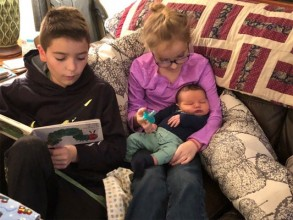 We love reading to our new baby brother!